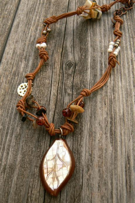 Industrial chic, with glass and shell beads on leather