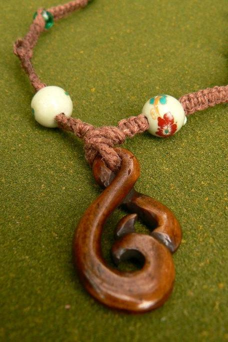 Knotted hemp necklace with twisted wooden pendant