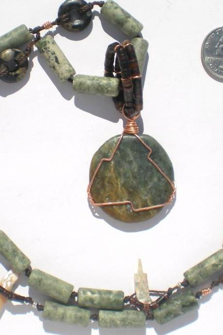 statement necklace in greens and browns