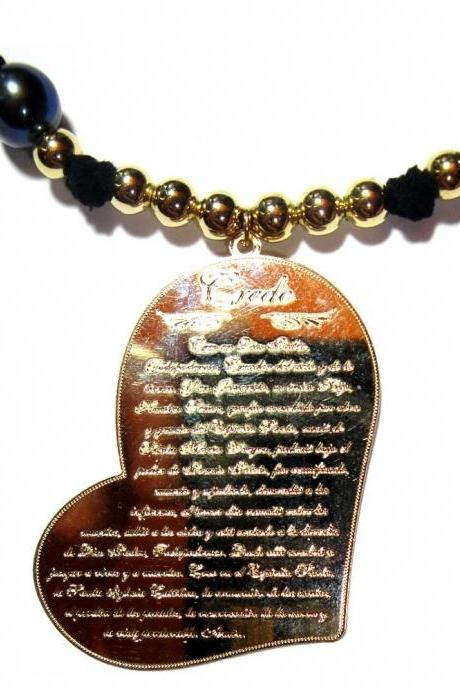 Black Iridescent Freshwater Pearl with gold filled accentuated by a gold Filled heart shaped medal (Apostle creed).