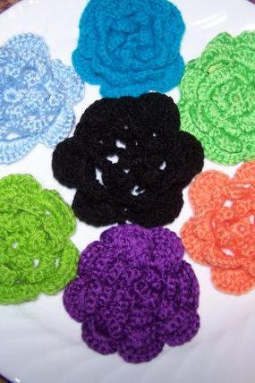 Two alligator clips with crochet flower.