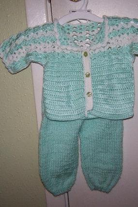 green and white Baby set