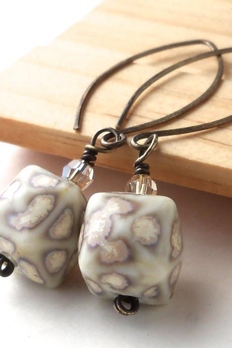 antiqued brass long dangle earrings with white ceramic beads