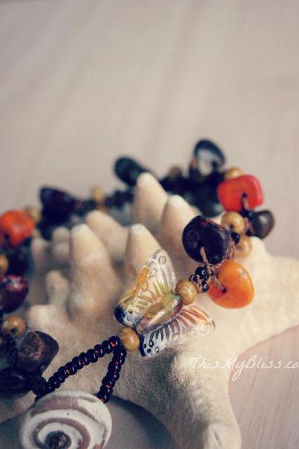 gemstone bracelet with a glass butterfly