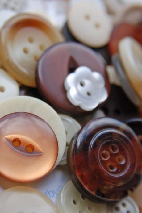 100g of Pure Indulgent Chocolatey Coloured Mixed Buttons.