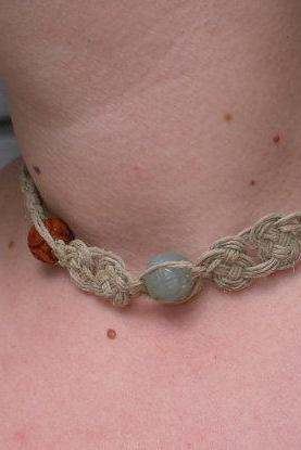 Carved Jade on natural hemp necklace.