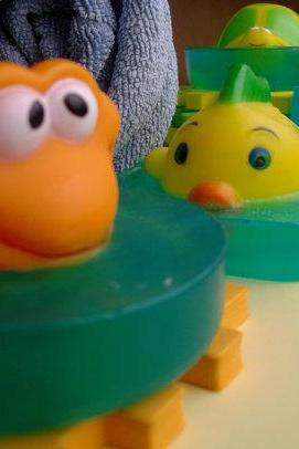 Children's bath toy in glycerin soap pond