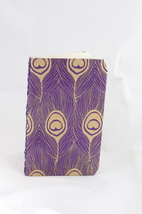 Golden peacock lined notebook.