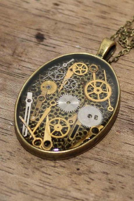 Pretty steampunk style pendant full of vintage hands of watch