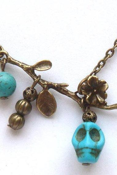 Antiqued Brass Branch Turquoise Skull Necklace