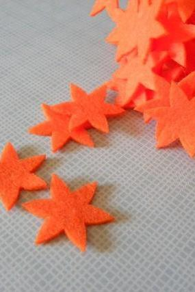 F135 10 felt flowers in one color 1.25 inch