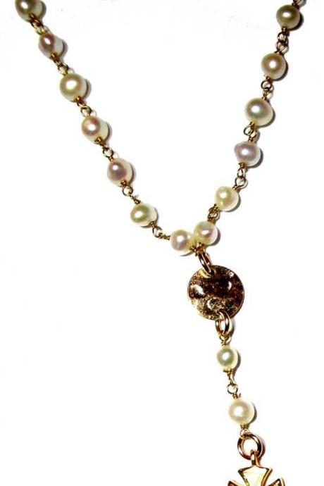 Rosary Style fresh water pearl wire wrapped necklace with a gold cross