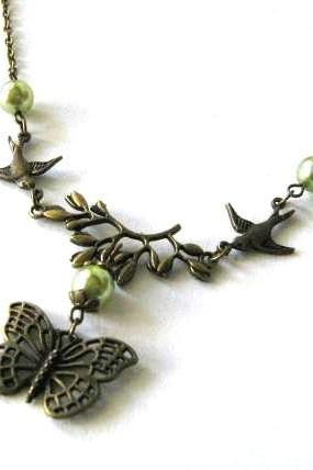 Bronze sparrows and butterfly necklace jewelry with light olive green pearls