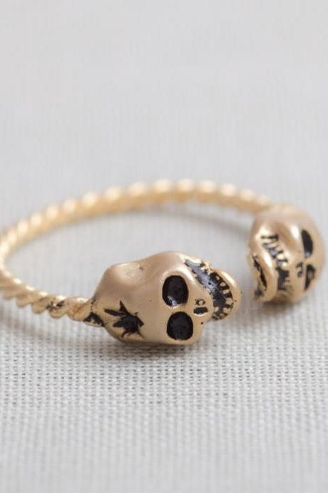 tiny skull heads ring in gold