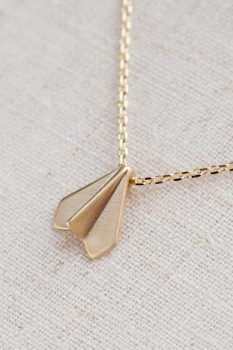 paper airplane necklace in gold