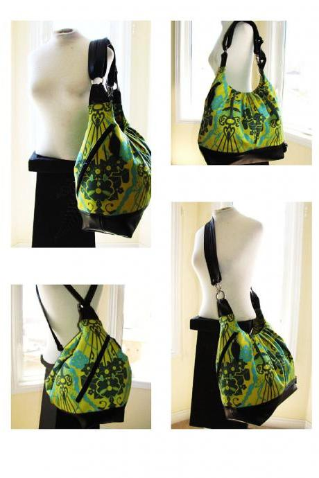Extra large convertible backpack purse in bouquet green turquoise fabric with leather straps and base