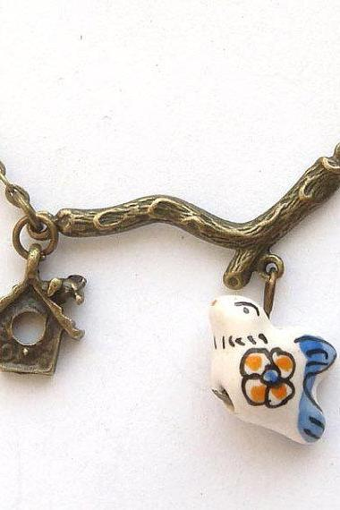 Antiqued Brass Branch Cage Porcelain Bird Necklace