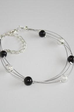 Multi strand floating illusion bracelet, black freshwater pearl and silver stardust beads, Hera.