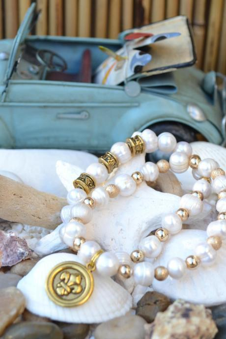 Fresh Water Pearls with small gold spacers, patterned gold accents, crystal rondelle & Fleur de Lis charm. Set of 2.