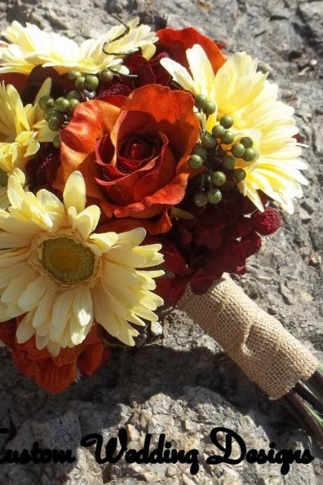 Real Touch Dasies, Rust/Orange Roses, Eva Berries and twisted vines. Great for that Fall Wedding. Satin, Camo or Burlap Ribbon.