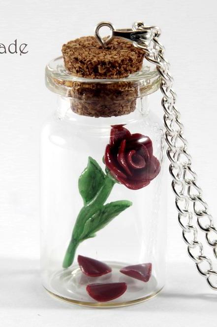 Rose with fallen petals in a glass jar necklace
