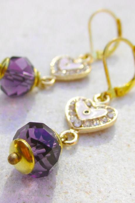 Earrings with rhinestone heart evil eye charms and purple crystals