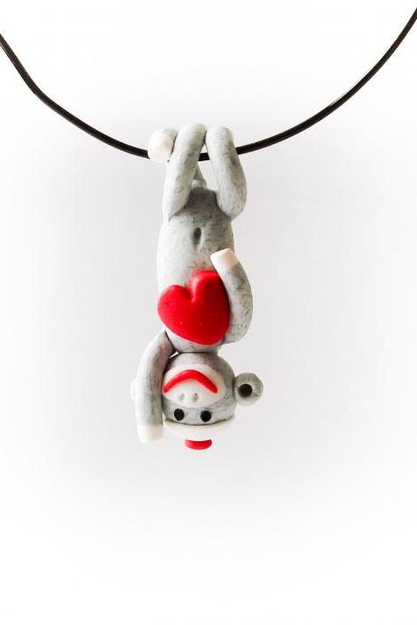 Grey Sock Monkey Pendant Swinging Upside Down holding a Valentine's Day Heart