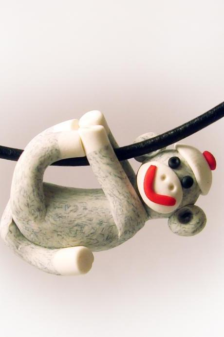 Gray Sock Monkey Pendant Swinging from all fours handmade in Polymer Clay