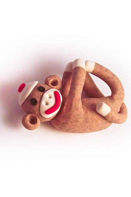 Brown Sock Monkey Pendant Swinging from all fours handmade in Polymer Clay